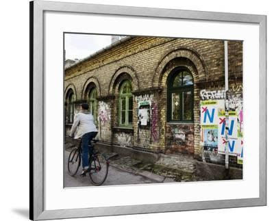 Cyclist in Freetown Christiania, with Anti European Union Posters on Wall-Christian Aslund-Framed Photographic Print