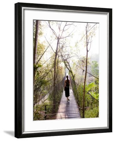 Woman Crossing Bridge Between Lobby and Accomodation Area at Four Seasons Tented Camp-Felix Hug-Framed Photographic Print