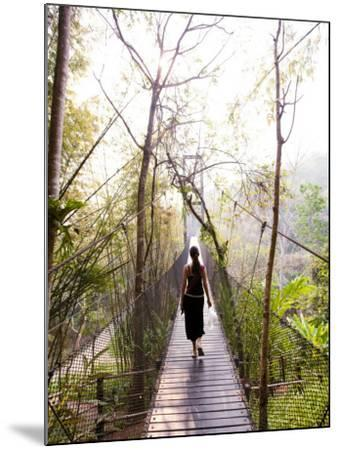 Woman Crossing Bridge Between Lobby and Accomodation Area at Four Seasons Tented Camp-Felix Hug-Mounted Photographic Print