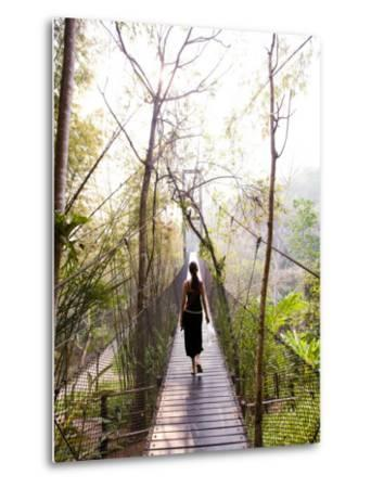 Woman Crossing Bridge Between Lobby and Accomodation Area at Four Seasons Tented Camp-Felix Hug-Metal Print