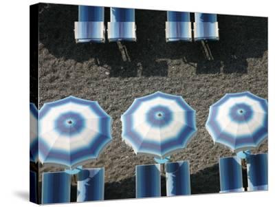 Beach Umbrellas-Karl Blackwell-Stretched Canvas Print