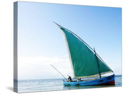 Dhow Sailing Off Coast of Vilanculos-Oliver Strewe-Stretched Canvas Print