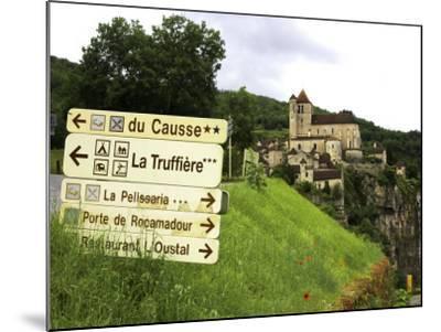 Tourist Signs Outside Village of St. Cirq Lapopie-Barbara Van Zanten-Mounted Photographic Print