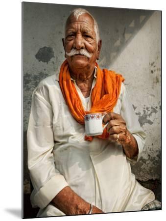 Man Drinking His Afternoon Chai-April Maciborka-Mounted Photographic Print