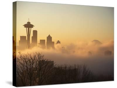 Morning Fog around Skyline with Sihouette of Space Needle and City Buildings-Aaron McCoy-Stretched Canvas Print