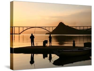 Couple Fishing from Stone Pier with Krk Bridge Joining Krk Island to Mainland-Ruth Eastham & Max Paoli-Stretched Canvas Print