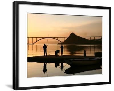 Couple Fishing from Stone Pier with Krk Bridge Joining Krk Island to Mainland-Ruth Eastham & Max Paoli-Framed Photographic Print