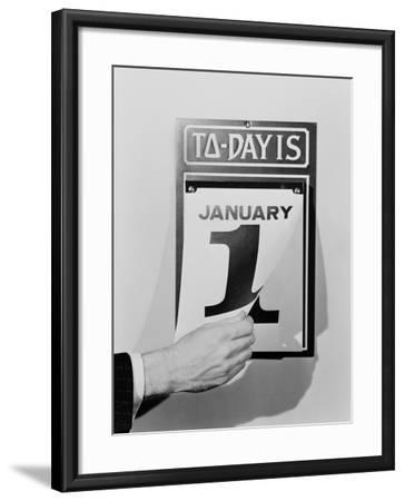 Man's Hand Tearing January 1 Page Off of Daily Wall Calendar-H^ Armstrong Roberts-Framed Premium Photographic Print