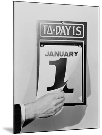 Man's Hand Tearing January 1 Page Off of Daily Wall Calendar-H^ Armstrong Roberts-Mounted Premium Photographic Print