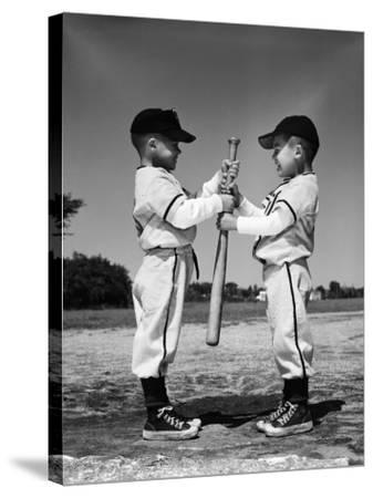 Two Boys in Little League Uniforms, Facing Each Other, Holding Baseball Bat-H^ Armstrong Roberts-Stretched Canvas Print