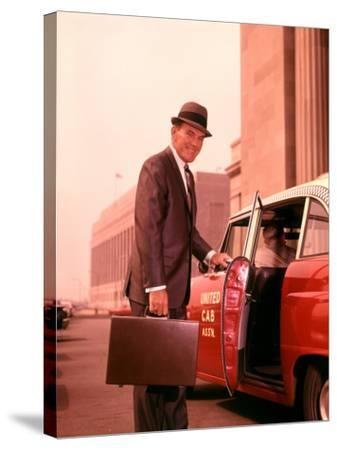 Salesman With Attache Case About To Enter Taxi Cab-H^ Armstrong Roberts-Stretched Canvas Print