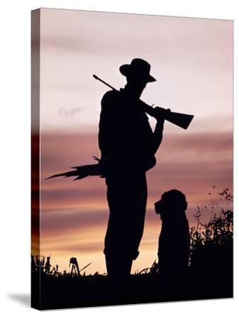 Silhouette of Man Hunter, Holding Rifle or Gun, Wearing Cowboy Hat-H^ Armstrong Roberts-Stretched Canvas Print
