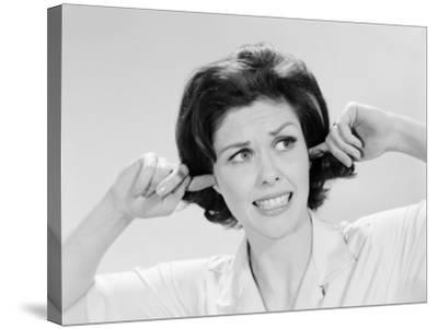 Woman Sticking Fingers in Her Ears-H^ Armstrong Roberts-Stretched Canvas Print