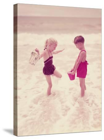 Boy and Girl Playing in Ocean Surf-H^ Armstrong Roberts-Stretched Canvas Print