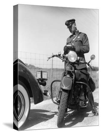 Policeman on a Motorcycle Writing a Ticket-H^ Armstrong Roberts-Stretched Canvas Print