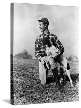 Man Kneeling Down Next To Setter, Arm Around Dog-H^ Armstrong Roberts-Stretched Canvas Print