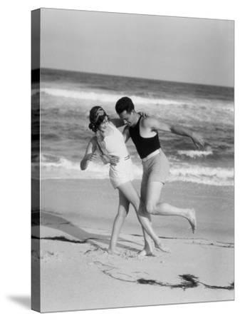 Couple Embracing on Sandy Beach-H^ Armstrong Roberts-Stretched Canvas Print