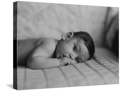 Portrait of Baby Boy (6-11 Months) Lying on Front With Fingers in Mouth-George Marks-Stretched Canvas Print