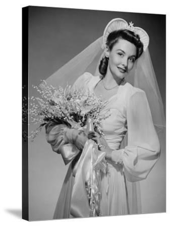 Bride Holding Bouquet, Posing in Studio, Portrait-George Marks-Stretched Canvas Print