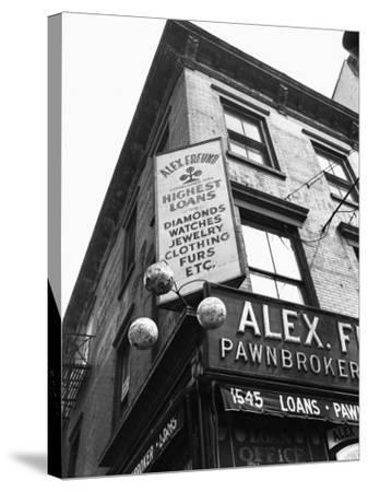 Comerical Sign at Building Corner, Low Angle View-George Marks-Stretched Canvas Print