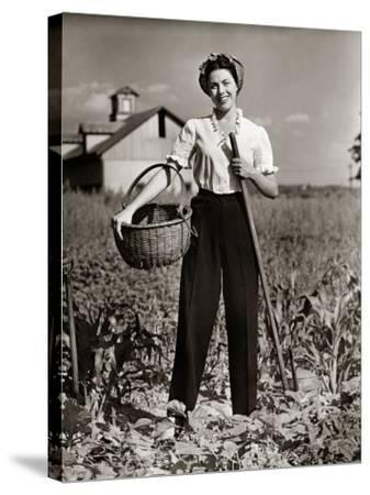 Woman Standing in Cornfield With Hoe and Basket-George Marks-Stretched Canvas Print