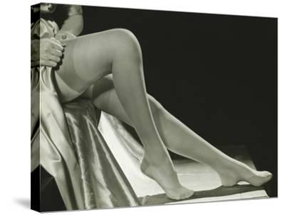 Woman Pulling on Stockings, Low Section-George Marks-Stretched Canvas Print
