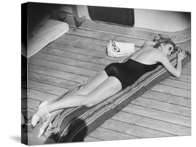 Young Woman Sun Tanning on Cruiser Deck-George Marks-Stretched Canvas Print