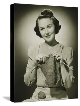 Young Woman Knitting in Studio, Portrait-George Marks-Stretched Canvas Print