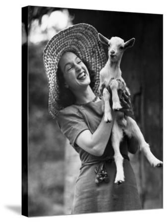 Woman Laughing and Holding a Goat-George Marks-Stretched Canvas Print