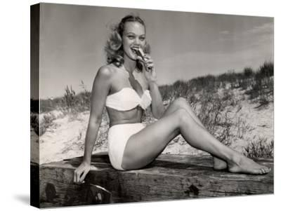 Woman Eating a Hot-Dog at the Beach-George Marks-Stretched Canvas Print