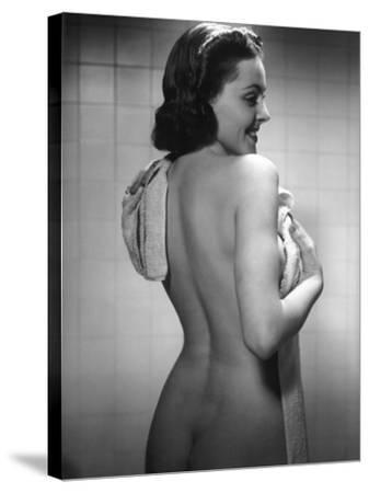 Naked Woman Drying Off With Towel-George Marks-Stretched Canvas Print