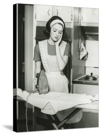 Young Woman Ironing in Kitchen-George Marks-Stretched Canvas Print
