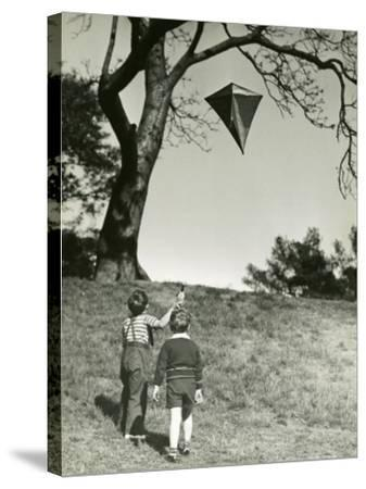 Small Boys Flying Kite-George Marks-Stretched Canvas Print
