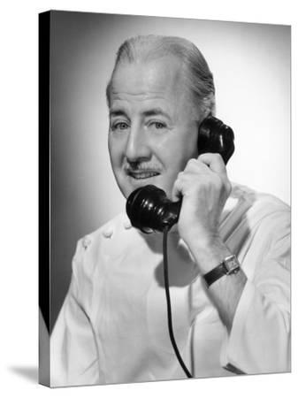 Doctor on the Telephone-George Marks-Stretched Canvas Print