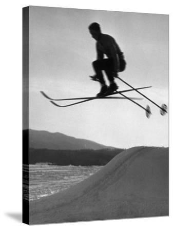 Skier in Mid Air-George Marks-Stretched Canvas Print
