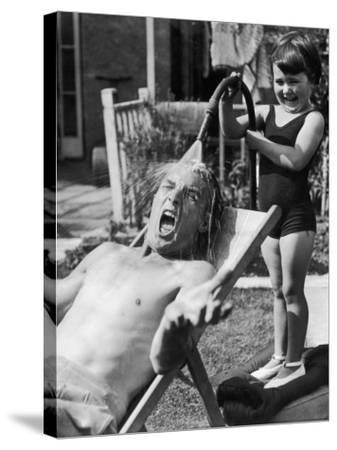 Hosing Down Dad--Stretched Canvas Print