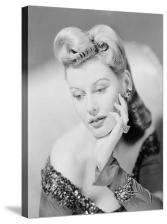 Studio Shot of Mid Adult Woman Resting Head on Hand-George Marks-Stretched Canvas Print
