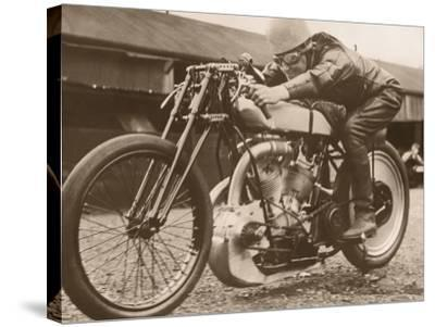 Man Sitting on Vintage Motorcycle--Stretched Canvas Print