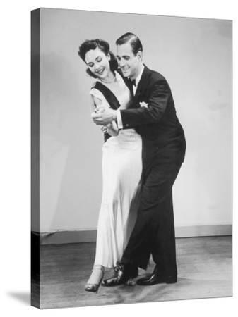 Couple in Formal Wear Dancing--Stretched Canvas Print