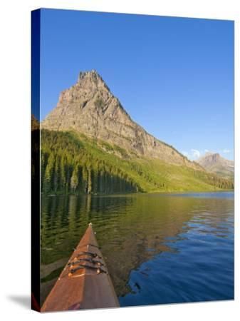 Kayaking on Two Medicine Lake in Glacier National Park, Montana, USA-Chuck Haney-Stretched Canvas Print