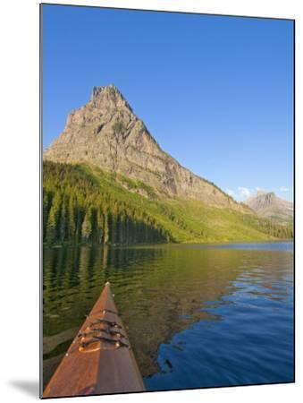 Kayaking on Two Medicine Lake in Glacier National Park, Montana, USA-Chuck Haney-Mounted Photographic Print