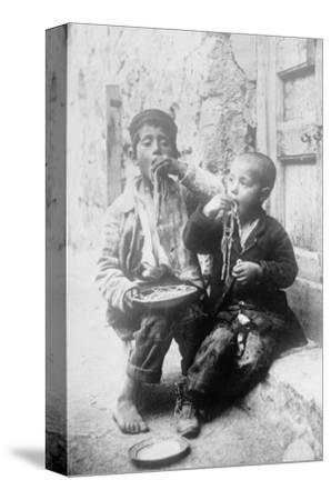 Two Neapolitan Children Slurp Down Spaghetti--Stretched Canvas Print