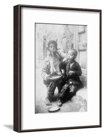 Two Neapolitan Children Slurp Down Spaghetti--Framed Art Print