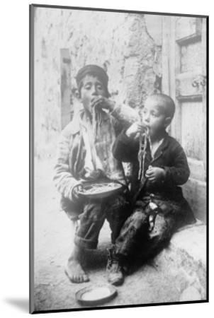 Two Neapolitan Children Slurp Down Spaghetti--Mounted Art Print