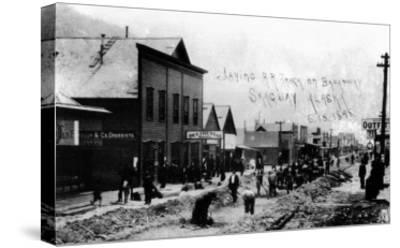 Skagway, Alaska - Laying Railroad Track on Broadway-Lantern Press-Stretched Canvas Print