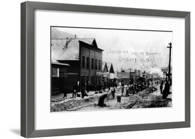 Skagway, Alaska - Laying Railroad Track on Broadway-Lantern Press-Framed Art Print