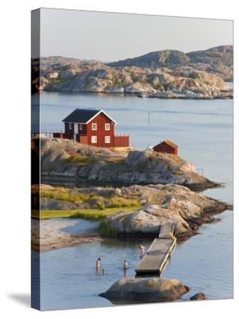 Bathing in Sea, Skarhamn on Island of Tjorn, Bohuslan, on West Coast of Sweden-Peter Adams-Stretched Canvas Print