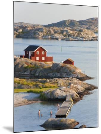 Bathing in Sea, Skarhamn on Island of Tjorn, Bohuslan, on West Coast of Sweden-Peter Adams-Mounted Photographic Print