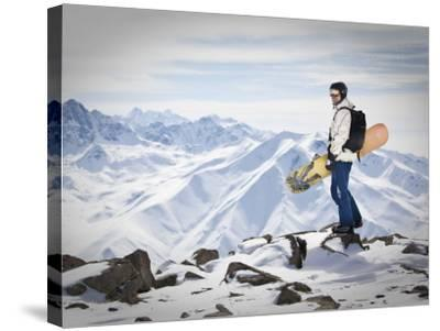 A Snowboarder at the Summit of Mount Affawat in Gulmarg, Kashmir, India-Julian Love-Stretched Canvas Print
