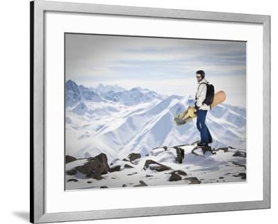 A Snowboarder at the Summit of Mount Affawat in Gulmarg, Kashmir, India-Julian Love-Framed Photographic Print